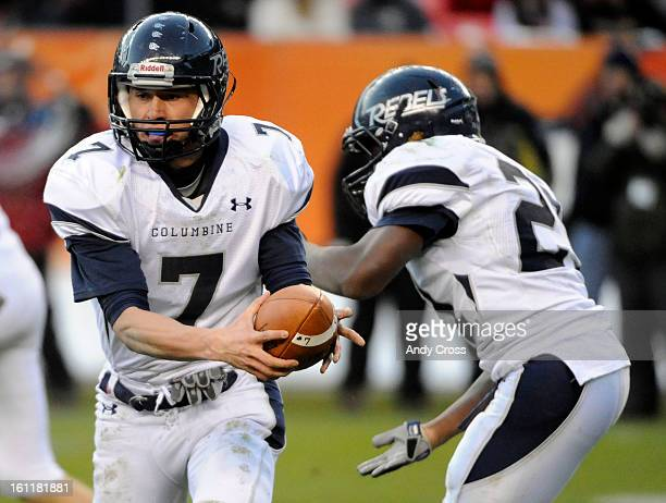 Columbine High School football QB Justin Brown hands off to RB Cameron McDondle during the Colorado State 5A Championship game against Lakewood High...