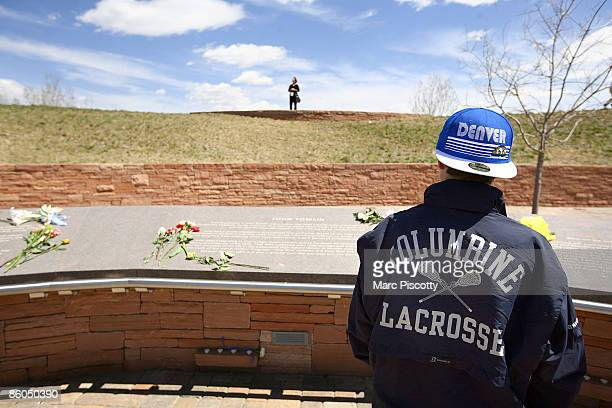 Columbine High School freshman Austin Pawelka commemorates the tenyear anniversary of the Columbine High School shootings at the Columbine Memorial...