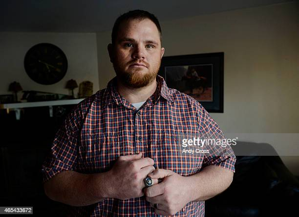 Columbine High School shooting survivor Evan Todd at his home with his newly found 1999 Columbine High School Championship football ring March 06...