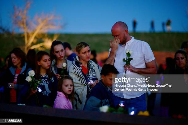 Columbine high school shooting survivor Will Beck right place flowers on the Columbine Memorial with his family during community vigil to honor and...