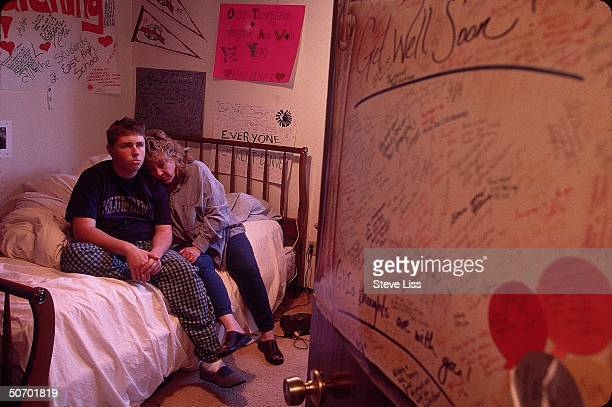 Columbine High School student Mark Taylor victim of student gunmen Eric Harris Dylan Klebold in their April massacre at school w mom Donna in his...