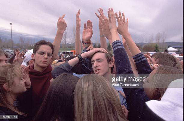 Columbine High School students praying in group evangelical Christian expression after trauma of April massacre at school by senior gunmen Eric...