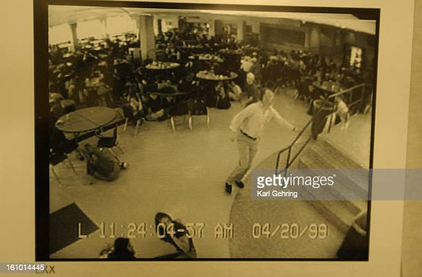 Columbine High School video surveilence camera captured this image of business teacher Dave Saunders climbing the stairs out of the school cafeteria...