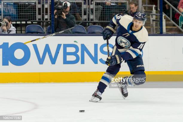 Columbus Blue Jackets center Alexander Wennberg attempts a shot and breaks his hockey stick in the first period of a game between the Columbus Blue...