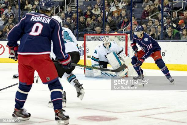 Columbus Blue Jackets center Alexander Wennberg receives a pass from Columbus Blue Jackets left wing Artemi Panarin in the third period of a game...
