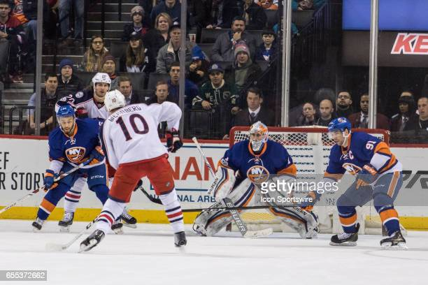 Columbus Blue Jackets Center Alexander Wennberg takes a shot on New York Islanders Goalie Thomas Greiss during the third period of a Metropolitan...