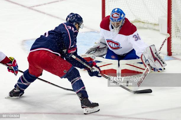 Columbus Blue Jackets center Boone Jenner attempts a shot on goal as Montreal Canadiens goaltender Charlie Lindgren blocks in the first period of a...