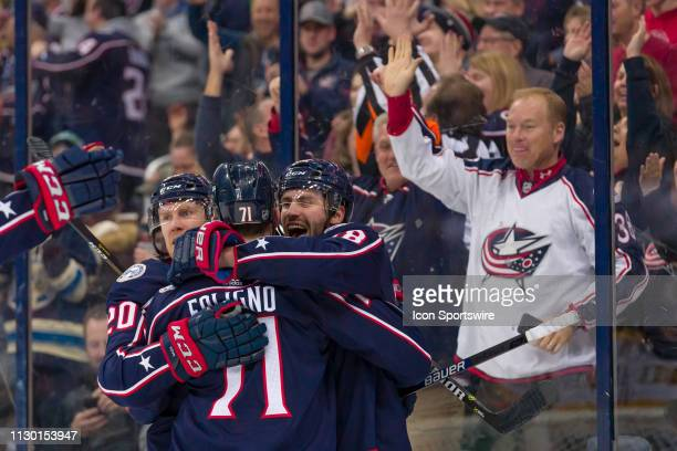 Columbus Blue Jackets center Boone Jenner celebrates with Columbus Blue Jackets center Riley Nash and Columbus Blue Jackets left wing Nick Foligno...