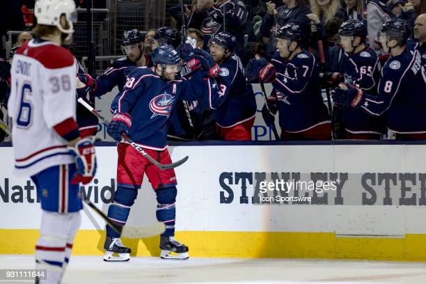 Columbus Blue Jackets center Boone Jenner celebrates with teammates after scoring a goal in the second period of a game between the Columbus Blue...