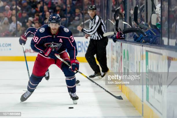 Columbus Blue Jackets center Boone Jenner pushes the puck along the boards in a game between the Columbus Blue Jackets and the Vancouver Canucks on...