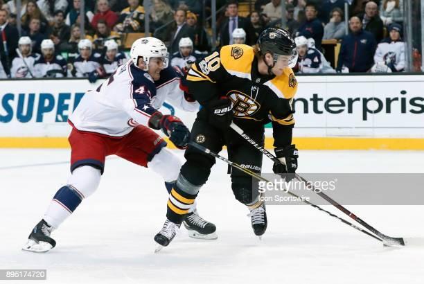 Columbus Blue Jackets center Lukas Sedlak pressures Boston Bruins left wing Anders Bjork during a game between the Boston Bruins and the Columbus...