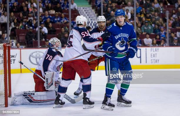 VANCOUVER BC MARCH 31 Columbus Blue Jackets Center Mark Letestu battles with Vancouver Canucks Center Adam Gaudette during the third period in a NHL...