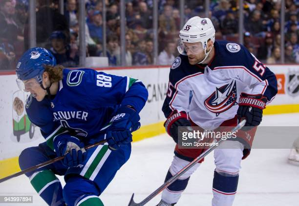 VANCOUVER BC MARCH 31 Columbus Blue Jackets Center Mark Letestu checks Vancouver Canucks Center Adam Gaudette during the third period in a NHL hockey...