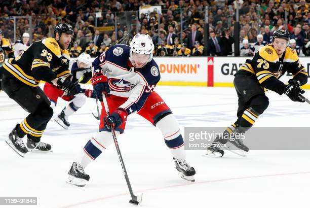 Columbus Blue Jackets center Matt Duchene controls the pic watched by ]Boston Bruins left defenseman Zdeno Chara and Boston Bruins right defenseman...