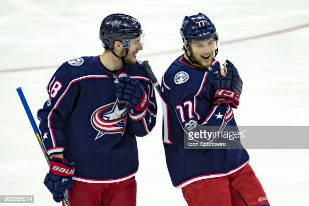 Columbus Blue Jackets center PierreLuc Dubois and Columbus Blue Jackets right wing Josh Anderson smile during a game between the Columbus Blue...