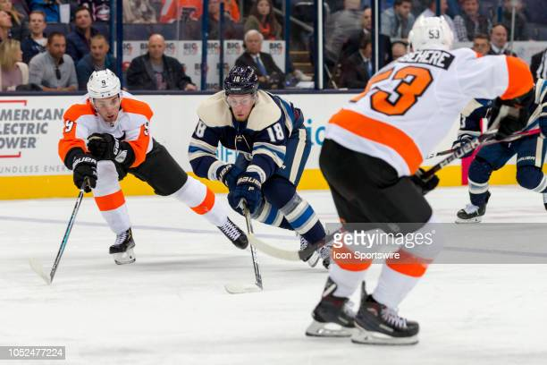 Columbus Blue Jackets center PierreLuc Dubois and Philadelphia Flyers defenseman Ivan Provorov battle for the puck in the first period of a game...