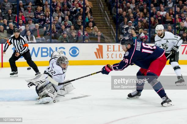 Columbus Blue Jackets center PierreLuc Dubois attempts a shot as Los Angeles Kings goaltender Jonathan Quick defends without his stick in a game...