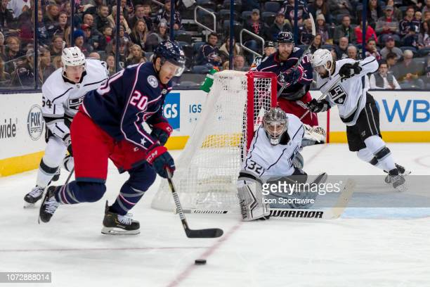 Columbus Blue Jackets center Riley Nash tries to get the puck back in front of Los Angeles Kings goaltender Jonathan Quick in a game between the...