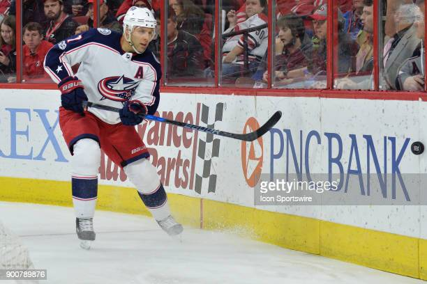 Columbus Blue Jackets Defenceman Jack Johnson plays the puck along the boards during a game between the Carolina Hurricanes and the Columbus Blue...