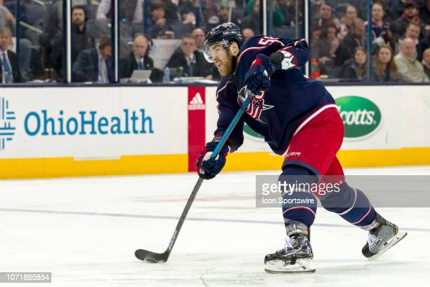 Columbus Blue Jackets defenseman David Savard attempts a shot on goal in a game between the Columbus Blue Jackets and the Vancouver Canucks on...
