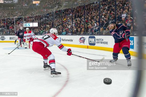 Columbus Blue Jackets defenseman David Savard passes the puck along the boards in a game between the Columbus Blue Jackets and the Carolina...