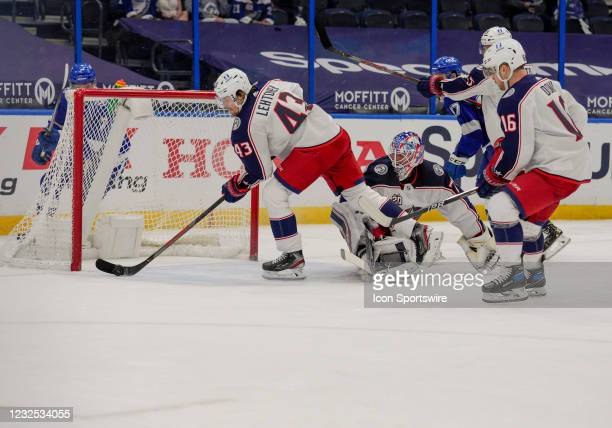 Columbus Blue Jackets defenseman Mikko Lehtonen makes a save and clears the puck during the NHL Hockey match between the Tampa Bay Lightning and...