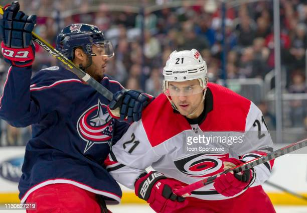 Columbus Blue Jackets defenseman Seth Jones battles with Carolina Hurricanes right wing Nino Niederreiter in a game between the Columbus Blue Jackets...