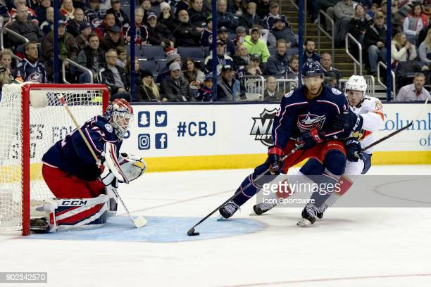 Columbus Blue Jackets defenseman Seth Jones clears the puck from the crease as Florida Panthers center Maxim Mamin pursues in the second period of a...