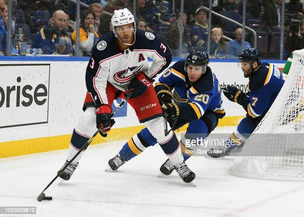 Columbus Blue Jackets defenseman Seth Jones skates with the puck ahead of St Louis Blues leftwing Alexander Steen during a NHL game between the...