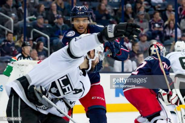 Columbus Blue Jackets defenseman Seth Jones tries to free his stick from Los Angeles Kings defenseman Drew Doughty in a game between the Columbus...