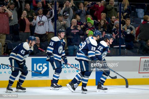 Columbus Blue Jackets fans cheer as Columbus Blue Jackets left wing Sonny Milano celebrates with teammates after scoring a goal in the third period...