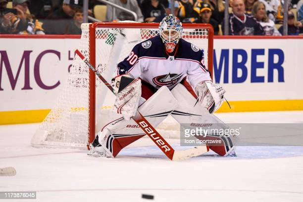 Columbus Blue Jackets Goalie Elvis Merzlikins tends net during the second period in the NHL game between the Pittsburgh Penguins and the Columbus...
