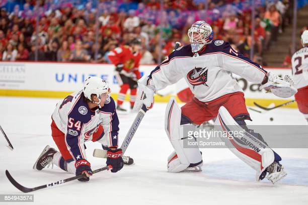 Columbus Blue Jackets goalie Joonas Korpisalo and Columbus Blue Jackets right wing Miles Koules react after colliding in the frst period during a...