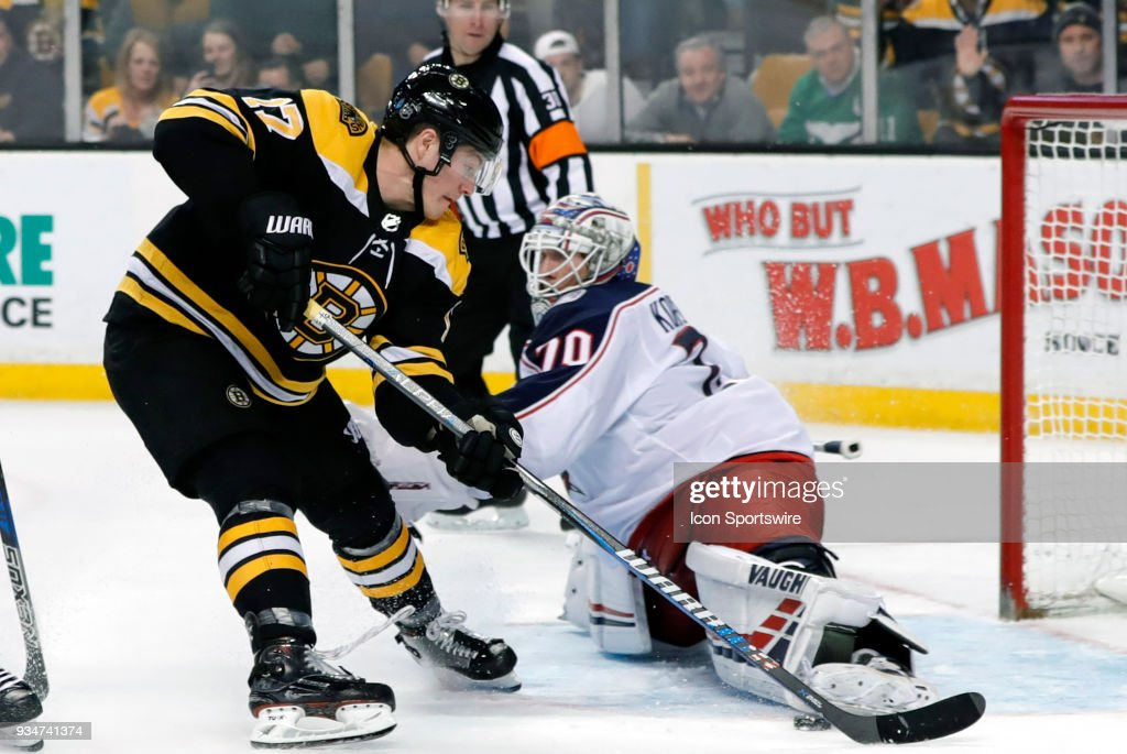 Columbus Blue Jackets goalie Joonas Korpisalo (70) gets his left pad on the puck to stop the breakaway from Boston Bruins center Ryan Donato (17) during a game between the Boston Bruins and the Columbus Blue Jackets on March 19, 2018, at TD Garden in Boston, Massachusetts. The Blue Jackets defeated the Bruins 5-4 (OT).