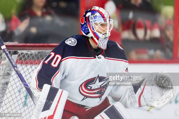 Columbus Blue Jackets Goalie Joonas Korpisalo prepares to make a save during warmup before National Hockey League action between the Columbus Blue...