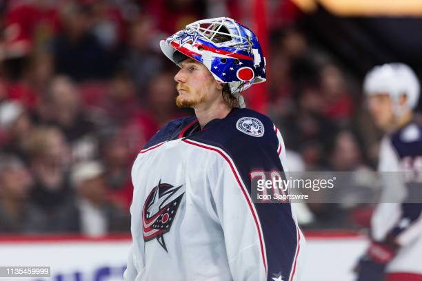 Columbus Blue Jackets Goalie Joonas Korpisalo with mask up returns to the net after a stoppage in play during second period National Hockey League...