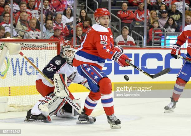 Columbus Blue Jackets goalie Sergei Bobrovsky makes a first period save as Washington Capitals right wing Brett Connolly tries to redirect the puck...