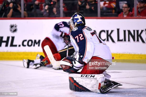 Columbus Blue Jackets Goalie Sergei Bobrovsky watches Calgary Flames Center Mikael Backlund and Columbus Blue Jackets Right Wing Josh Anderson...