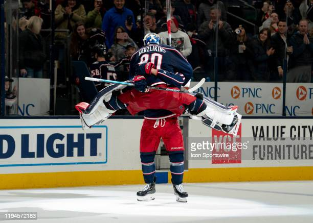 Columbus Blue Jackets goaltender Elvis Merzlikins celebrates a victory after the game between the Columbus Blue Jackets and the New Jersey Devils at...
