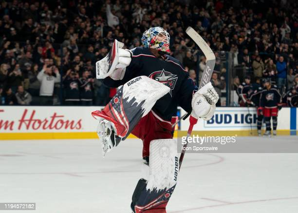 Columbus Blue Jackets goaltender Elvis Merzlikins celebrates a win after the game between the Columbus Blue Jackets and the New Jersey Devils at...