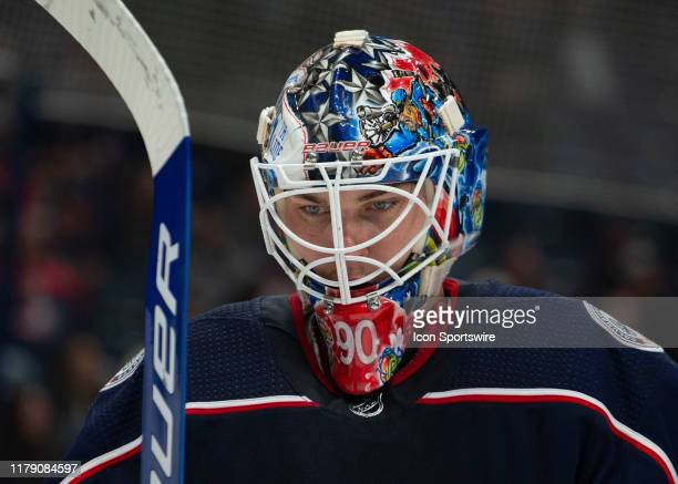 Columbus Blue Jackets goaltender Elvis Merzlikins looks on during a tv time out during the game between the Columbus Blue Jackets and the Edmonton...