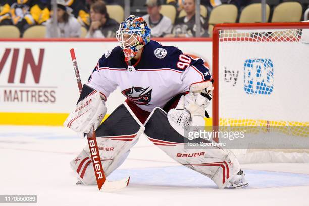 Columbus Blue Jackets goaltender Elvis Merzlikins tends net during the first period in the NHL game between the Pittsburgh Penguins and the Columbus...