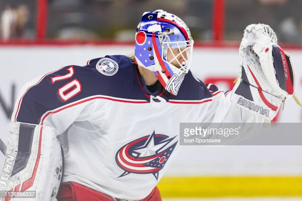 Columbus Blue Jackets goaltender Joonas Korpisalo makes a glove save during warmup before National Hockey League action between the Columbus Blue...