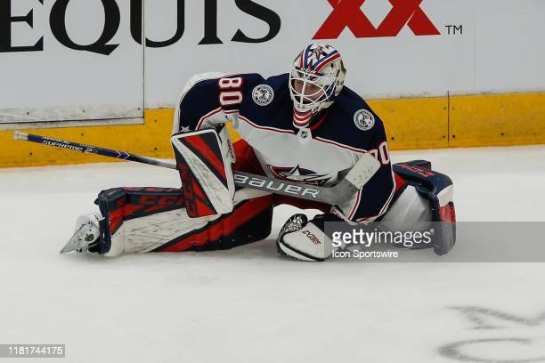 Columbus Blue Jackets goaltender Matiss Kivlenieks warms up before the NHL hockey game between the Columbus Blue Jackets and the Arizona Coyotes on...