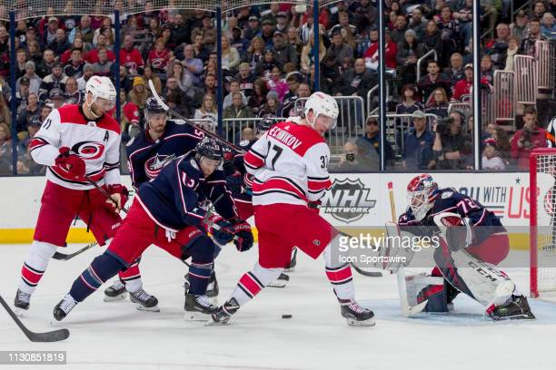 Columbus Blue Jackets goaltender Sergei Bobrovsky deflects a shot from Carolina Hurricanes right wing Andrei Svechnikov in a game between the...
