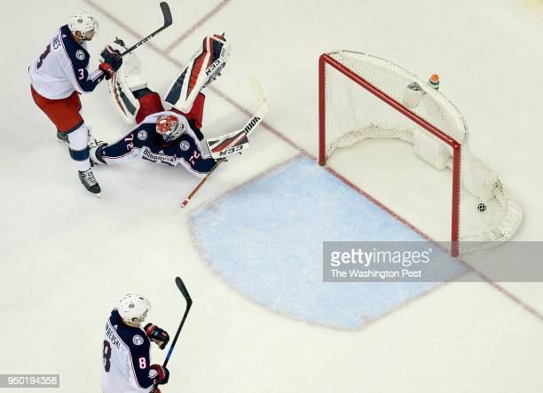 WASHINGTON DC APRIL Columbus Blue Jackets goaltender Sergei Bobrovsky falls on his back after the game winning goal by Washington Capitals center...