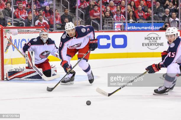 Columbus Blue Jackets goaltender Sergei Bobrovsky makes a save as defenseman Seth Jones moves the puck out in action on February 9 at the Capital One...
