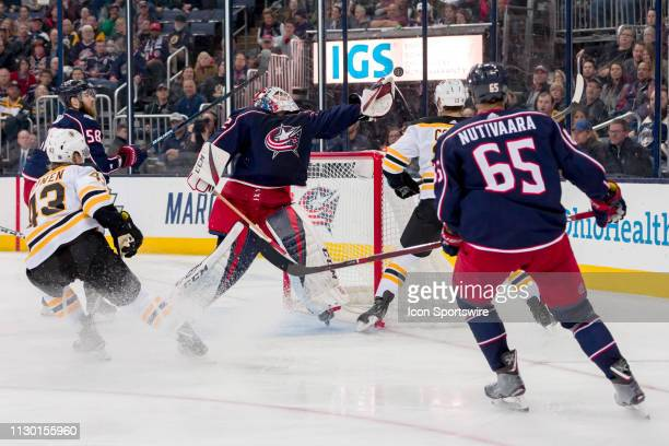Columbus Blue Jackets goaltender Sergei Bobrovsky stretches for the puck in a game between the Columbus Blue Jackets and the Boston Bruins on March...