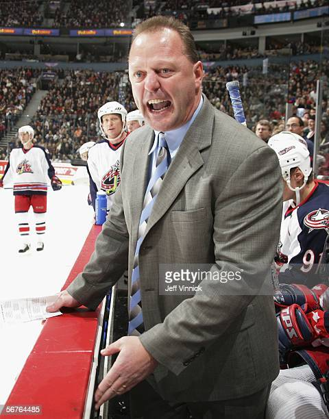 Columbus Blue Jackets head coach Gerard Gallant complains to the referee that Todd Bertuzzi of the Vancouver Canucks was playing with blood on his...
