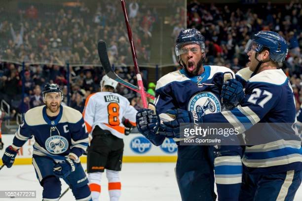Columbus Blue Jackets left wing Anthony Duclair celebrates with Columbus Blue Jackets defenseman Ryan Murray after scoring a goal in the first period...